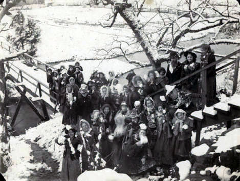 Young women holding snowballs at a footbridge in Montevallo, Alabama. ca. 1899