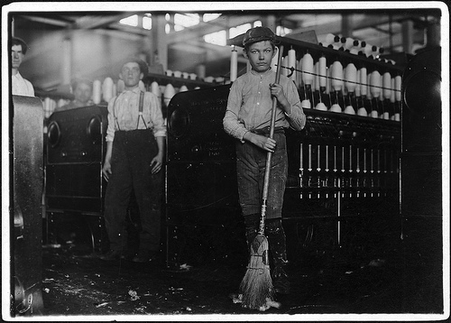 Young sweeper in Annniston Yarn Mill Nov. 1910 photo by Lewis Hines