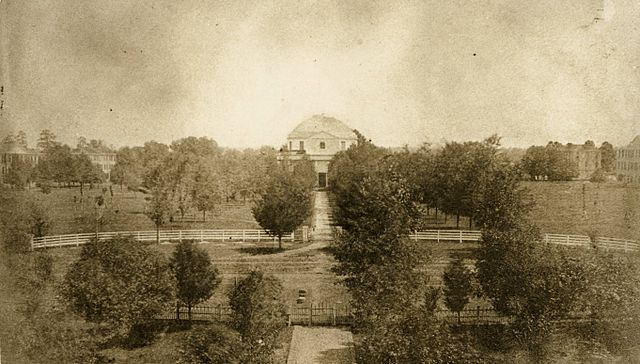 The campus of the University of Alabama in 1859. View of the Quad, with the Rotunda at center and dormitories in the background. All of these buildings were destroyed by the Union army