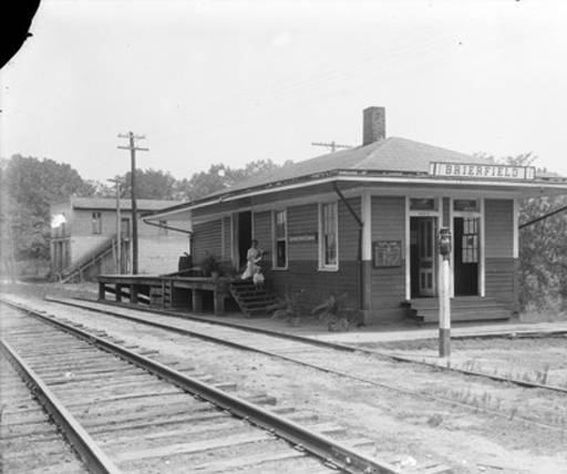Edna Bayne Pfaff and her son, Ross, at the railroad depot in Brierfield, Alabama ca. 1900