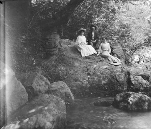 Annie Pfaff and others, seated on a rock beside Mahan Creek at Brierfield, Alabama ca. 1900, photo at Alabama State Archieves