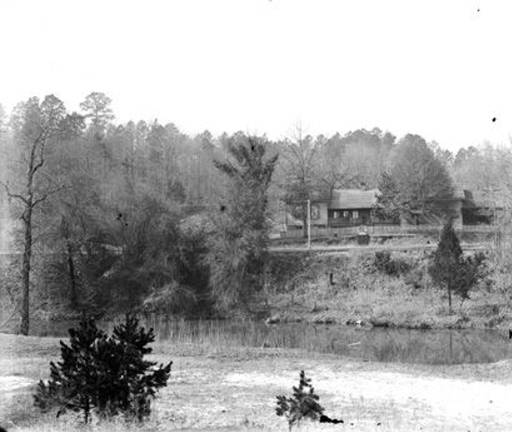 Mahan Creek is in the foreground. Herman Pfaff, president of Southern Mineral Land Company, lived in the house with his family ca. 1900 - photo at Alabama State Archives