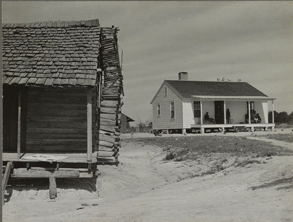 Part of old house and new home of Little Pettway's family. Gee's Bend, Alabama, photograph taken by M. P. Walcott