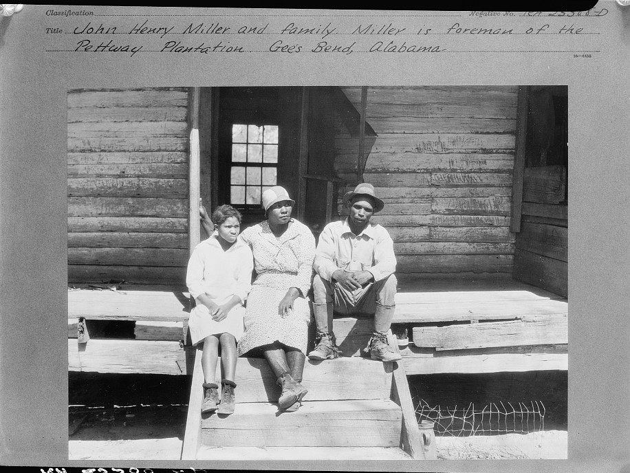 John Henry Miller and family. Miller is foreman of the Pettway Plantation. Gees Bend, Alabama, photograph taken 1937 by Arthur Rothstein