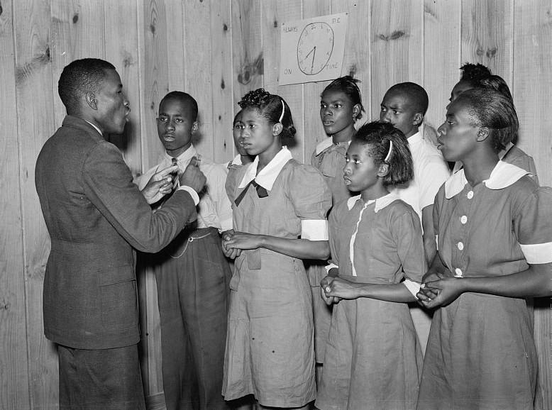 School Choir led by Robert Pierce, principal, They won state championship, photo taken by M. P. Walcott