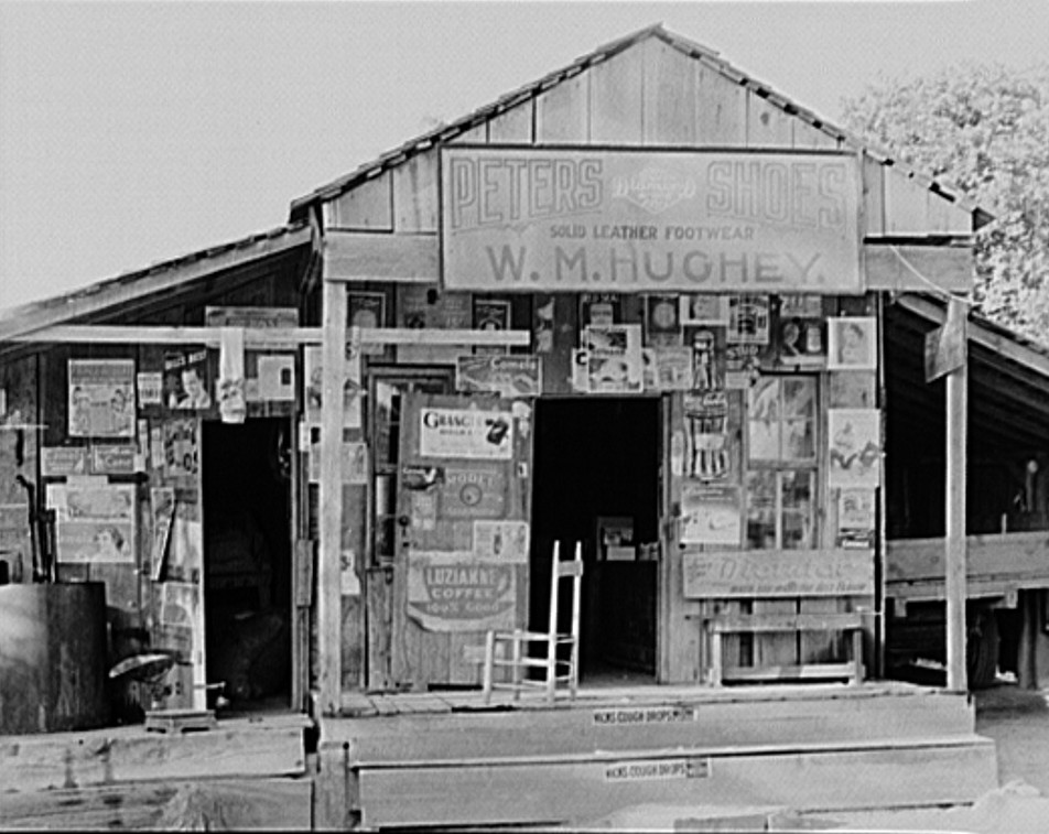This may be the outside of the general store above. July 1936