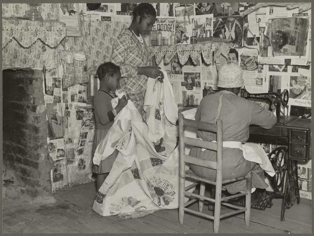 sewing a quilt 1937