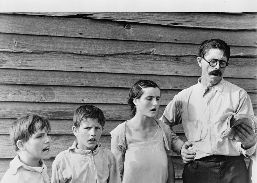 Frank Tengle, an Alabama sharecropper, and family singing hymns. by Photograher Walker Evans