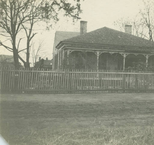 Mrs. E. C. Perry's home in Glennville, Alabama According to a note on the back, the house was