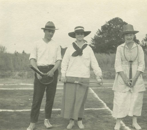 Two men and two women holding tennis racquets and standing on a court in Glennville, Alabama ca. 1917 state archives