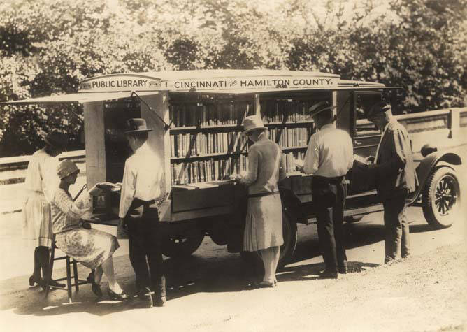 Adults_browsing_at_a_bookmobile_for_Cincinnati_and_Hamilton_County_in_Ohio