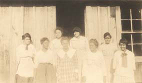 Eight_young_African_American_women_outside_a_school_building_in_Bibb_County_Alabama