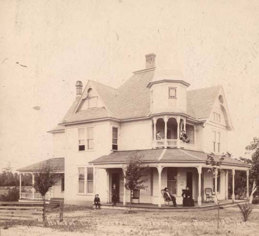Home of T. T. Thorsby sitting on porch - Alabama archives