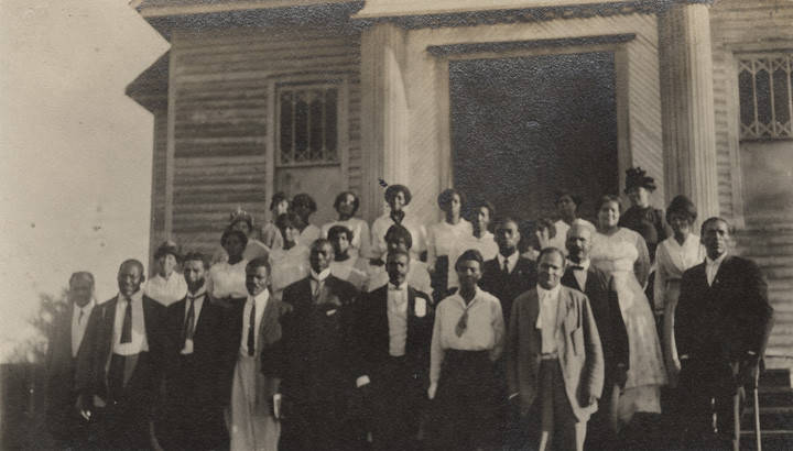 African_American_teachers_standing_on_the_steps_of_a_wooden_church_building_in_Clayton_Alabama