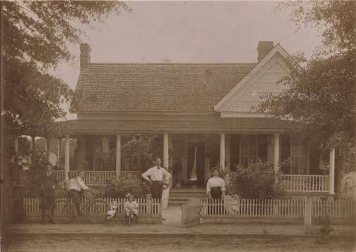 George_Reynolds_and_family_standing_in_front_of_their_home_in_Clayton_Alabama