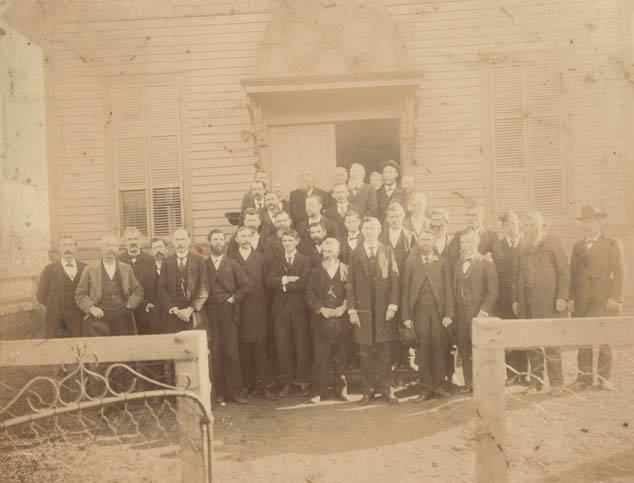 James Hugh Blair Hall stands on the first row, seventh from the left. All the men in the photograph are identified.