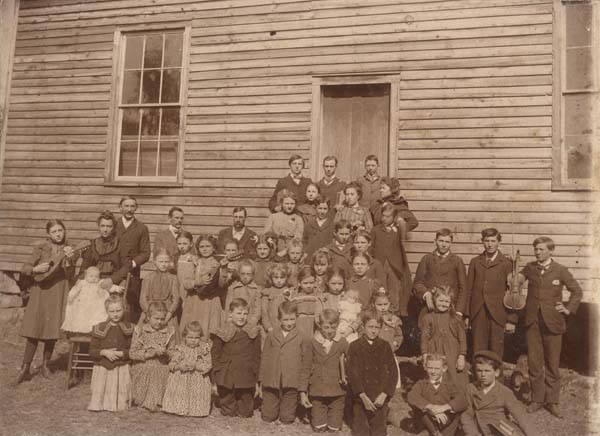 Reverend_James_Hugh_Blair_Hall_with_the_students_of_the_Zelosophian_Academy_outside_the_Rosedale_Cumberland_Presbyterian_Church_building_in_Jefferson_County_Alabama