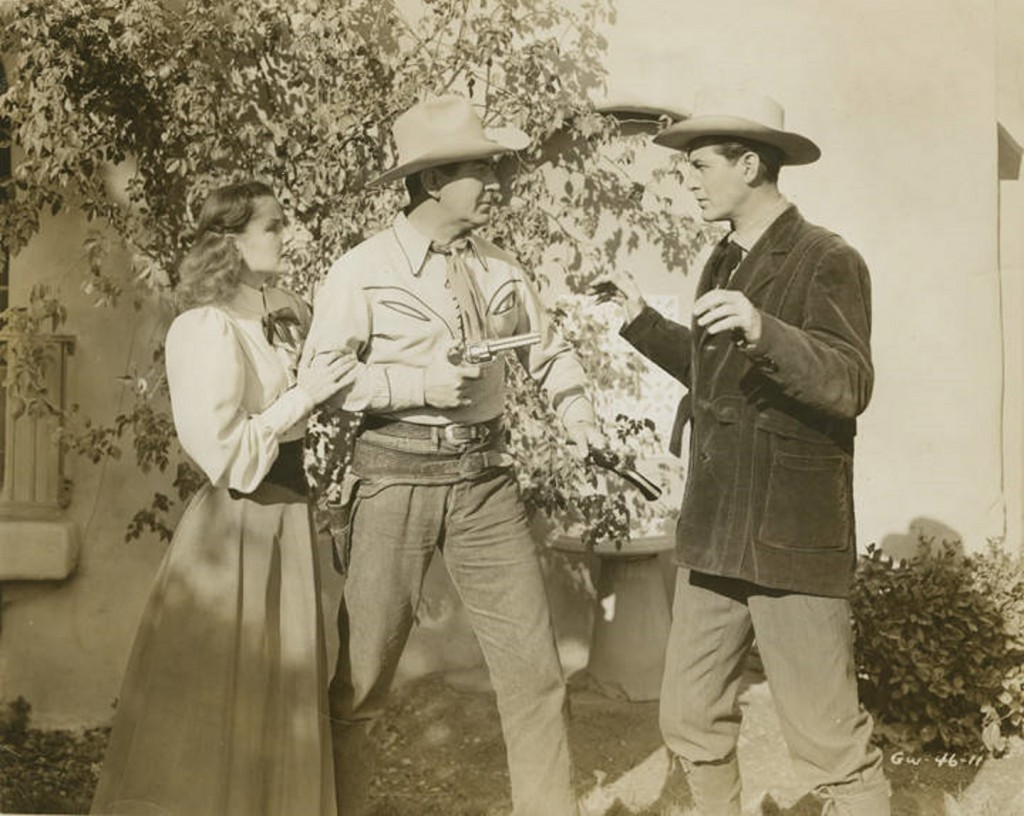 Johnny_Mack_Brown_performing_in_a_western_movie