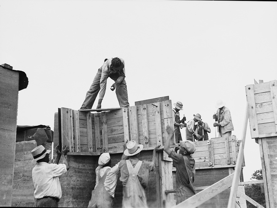 Rammed earth construction near Birmingham, Alabama. Forms sections should not be larger than can be handled by a crew of three or four men