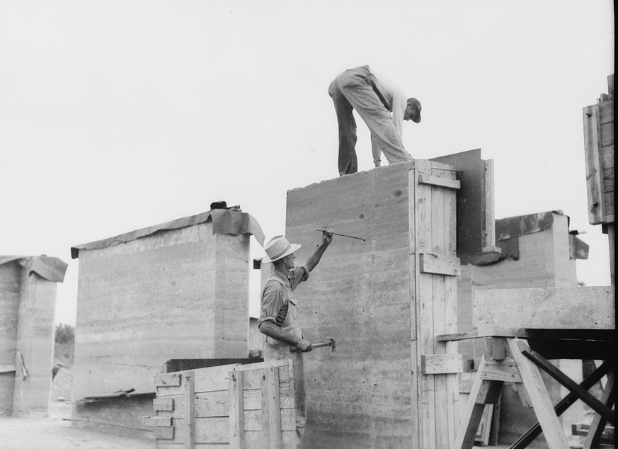 Rammed earth construction near Birmingham, Alabama. The bolts are removed and the holes plugged with mortar