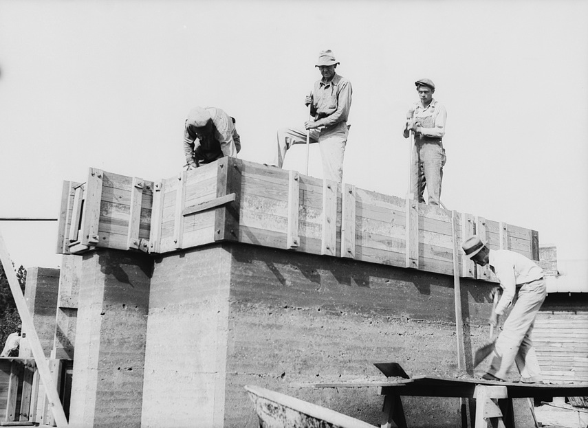 Rammed earth construction near Birmingham, Alabama. Three-inch layers are tamped in the forms until it is filled