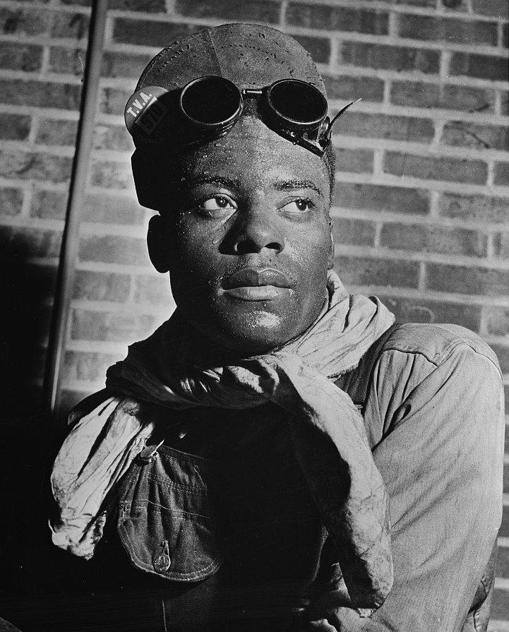 Alonzo Bankston is a furnace operator in the TVA plant producing carbide for use of plants manufacturing synthetic rubber 1942 by Alfred Palmer