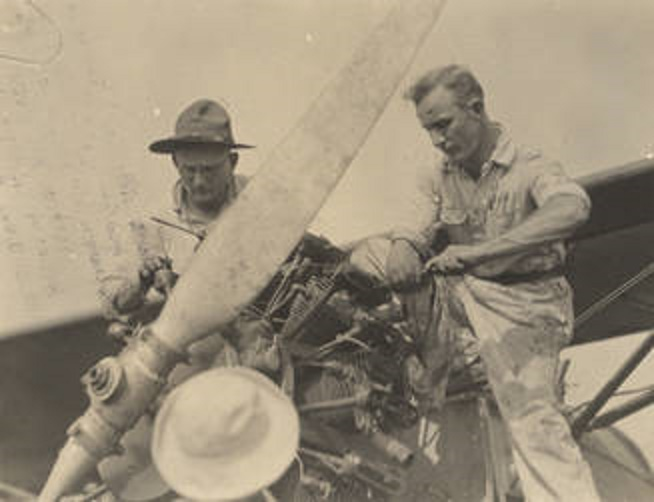Two_men_working_on_an_airplane_engine_at_the_Air_Corps_base_at_Roberts_Field_in_Birmingham_Alabama Q8936