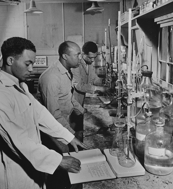 (left to right) Paul L. Imes, Samuel C. Watkins, and George W. Richardson are employed as laboratory technicians by TVA at its plant 1942