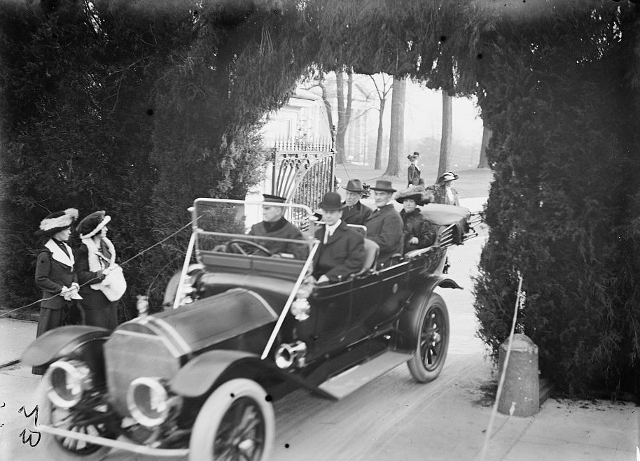 President Wilson and his wife leave White House by car