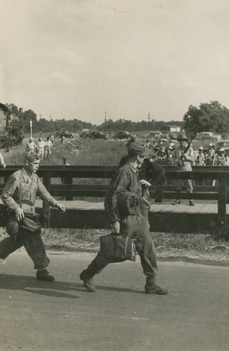 German Prisoners of War marching to camp at Aliceville.