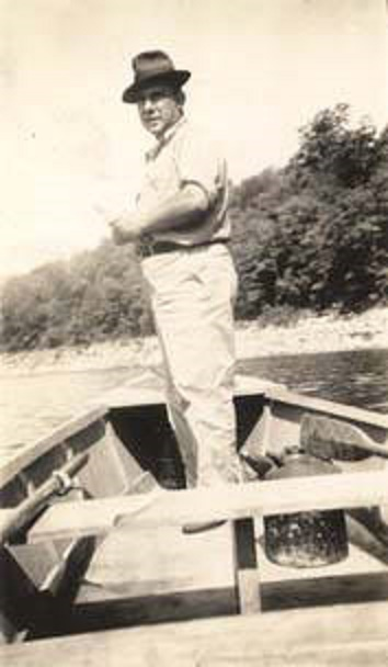 Man_standing_in_a_rowboat_and_fishing July 30, 1937 Lollars Birmingham Q2248