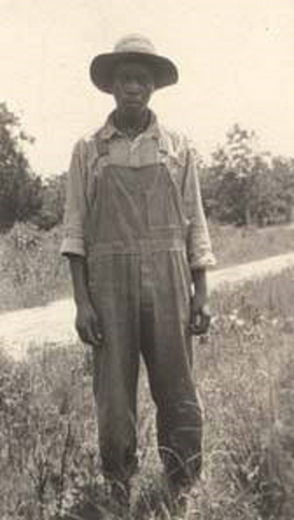 African American man standing in a field in Russell County, Alabama Q5645
