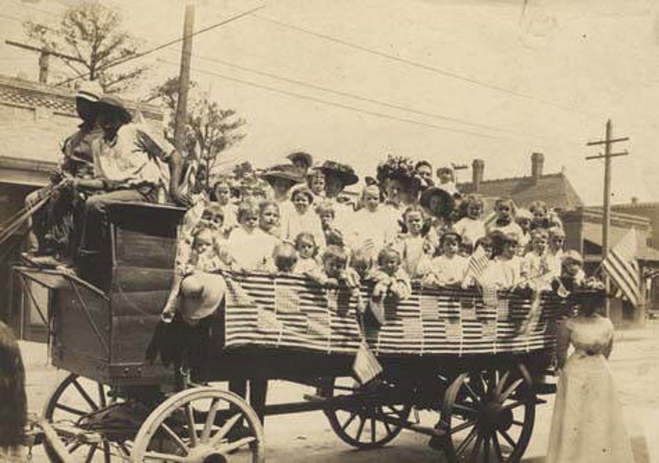 Children and adults in the back of a wagon, ready for the Annual Kindergarten Picnic in Ensley ca. 1900-1910 – . Q5517