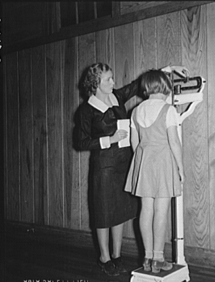 Nurse, Miss Teal, weighing child in health room of Goodman School. Coffee County, Alabama