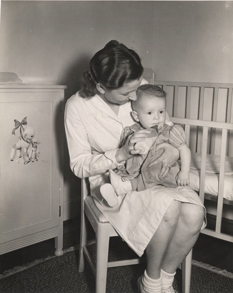 Auburn girls learn practical problems of infant care at the nursery school bottle ca. 1940 Q1612