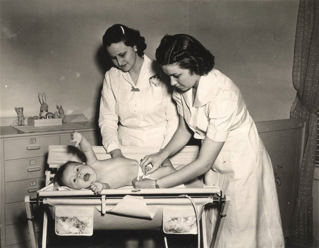 Auburn girls learn practical problems of infant care at the nursery school. ca. 1940 Q1620