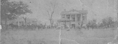 Early pictures from Bibb County, Alabama includes photograph of courthouse before it was razed in 1890 to build current one