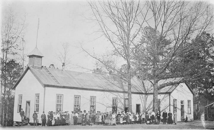 Children and adults in front of a school building in Woodstock, Alabama. ca. 1913 Q42793