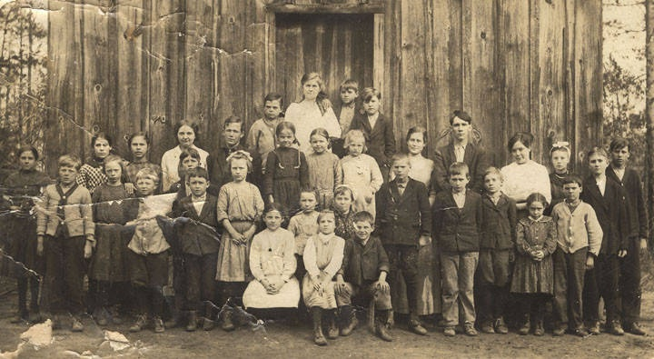 Students standing in front of a one-room schoolhouse in Randolph, Alabama Q9457