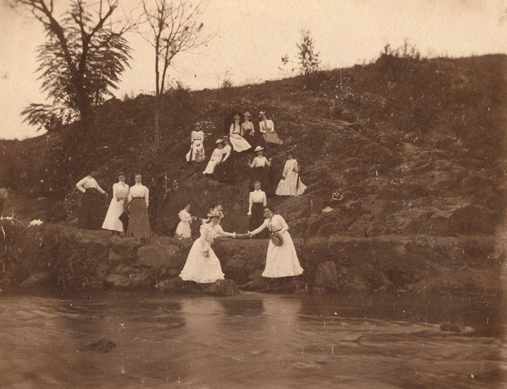 Young women on the bank of a spring near Montevallo, Alabama photographed by R. W. Caleton, Montevallo, Alabama Q8925