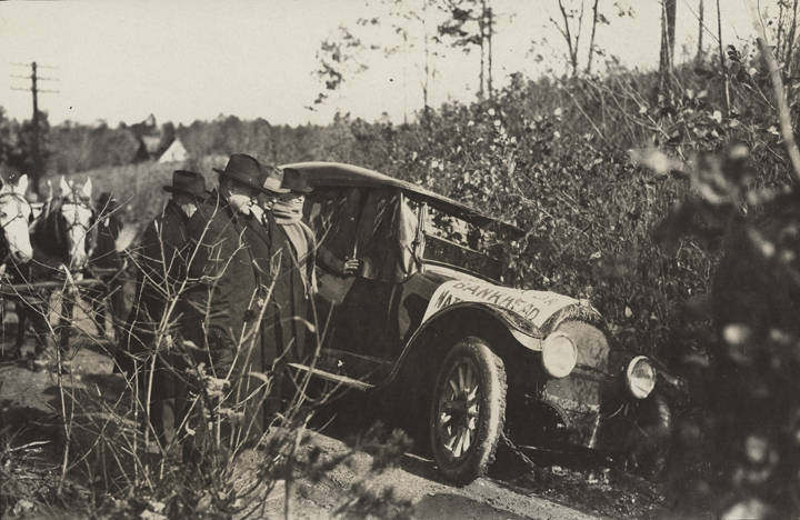 Car stuck in the mud on a road in Virginia, probably during a cross-country trip to determine the route of the Bankhead Highway (ADAH)