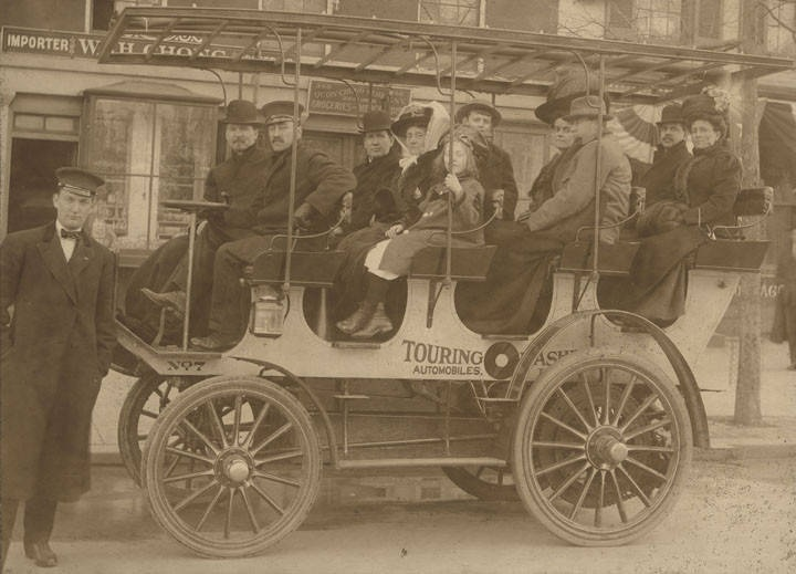 Passengers on a small bus in downtown Evergreen, Alabama ca. 1890-1909 from Frank Leslie Riley photographs Q8540