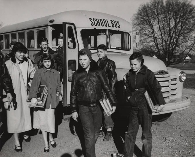Students getting off a school bus in Alabama Pierce Laurens photographer, Montgomery, Alabama ca. 1940-1959 Q40553