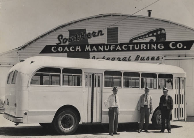 Three men standing in front of a bus built by (and parked at) the Southern Coach Manufacturing Company in Evergreen, Alabama photographer Clayton Albert, Birmingham, Alabama ca. 1940-1949 Q36704