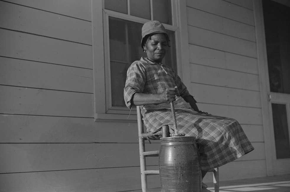 Gertrude, churning on Isaiah Pettway's porch, Gees Bend, Alabama