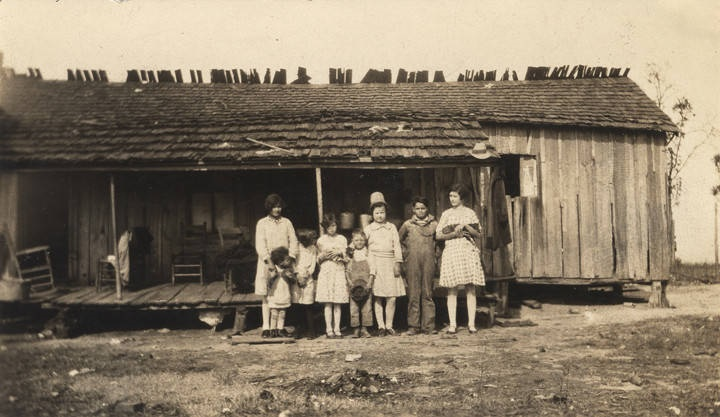 Group of Cajun children standing in front of a home in Mobile County, Alabama Q5421