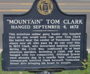 Outlaw Mountain Tom Clark is buried under Tennessee Street in Florence, Alabama
