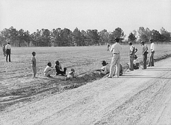Watching a Saturday afternoon ballgame (the first one). It has been very difficult to start recreational activities because of objections of old preacher. Gee's Bend, Alabama