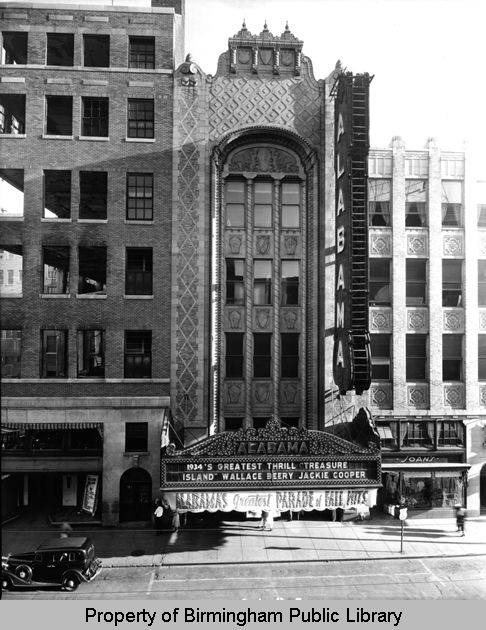 Alabama Theatre marquee Treasure Island with Wallace Beery and Jackie Cooper. To the left is the burned-out shell of Loveman, Joseph and Loeb Departmen 1934