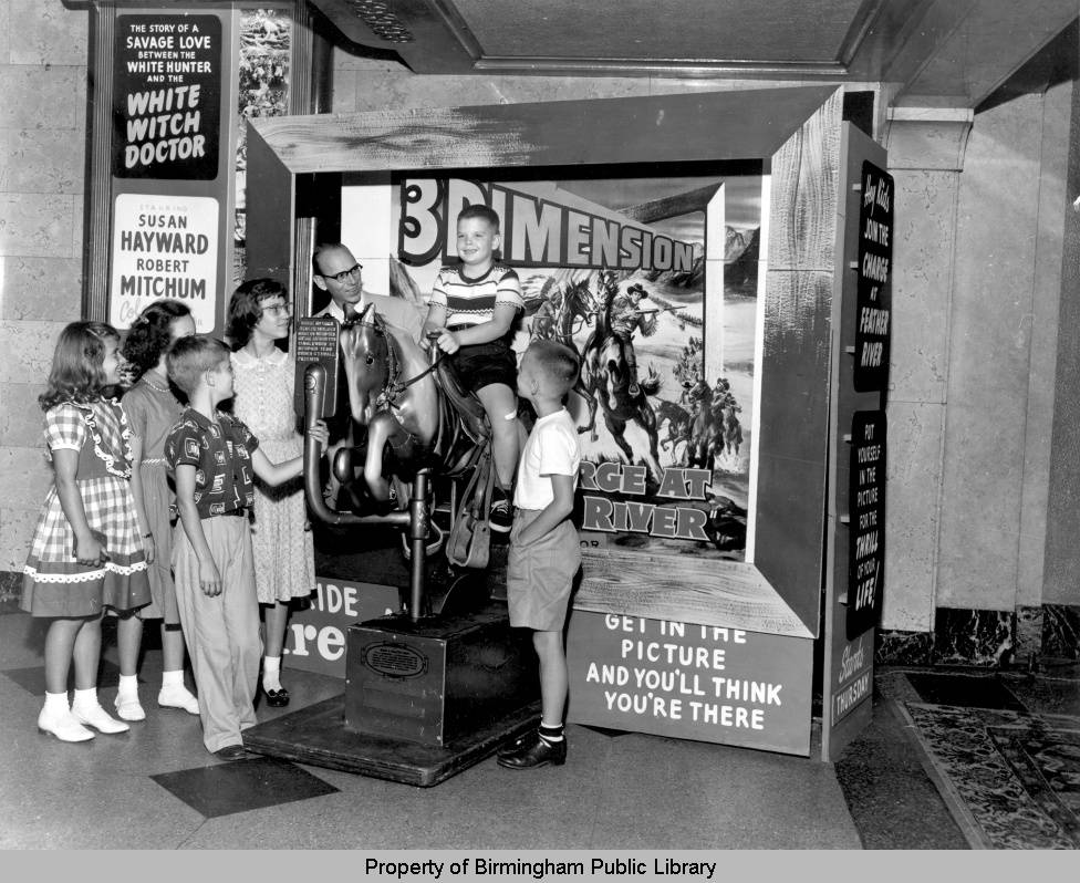 Boy_riding_coin_operated_horse_at_the_Alabama_Theatre ca. 1950s